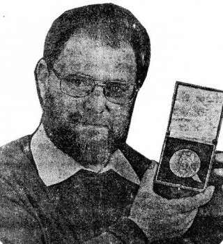 Harry Ford, showing the Lorimer medal.