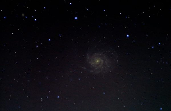 "M101 Pinwheel Galaxy ( Jonathan Anderson) 4"" f10 achro on HEQ5 Pro Canon 700d (umod) @ISO 1600 120x40sec + darks,flats etc. Processed DSS & GIMP Gradients below the galaxy show how this has been stretched to the limit. Less stretch leaves the spirals disappointing. As Pat said recently - this target could do with more time."