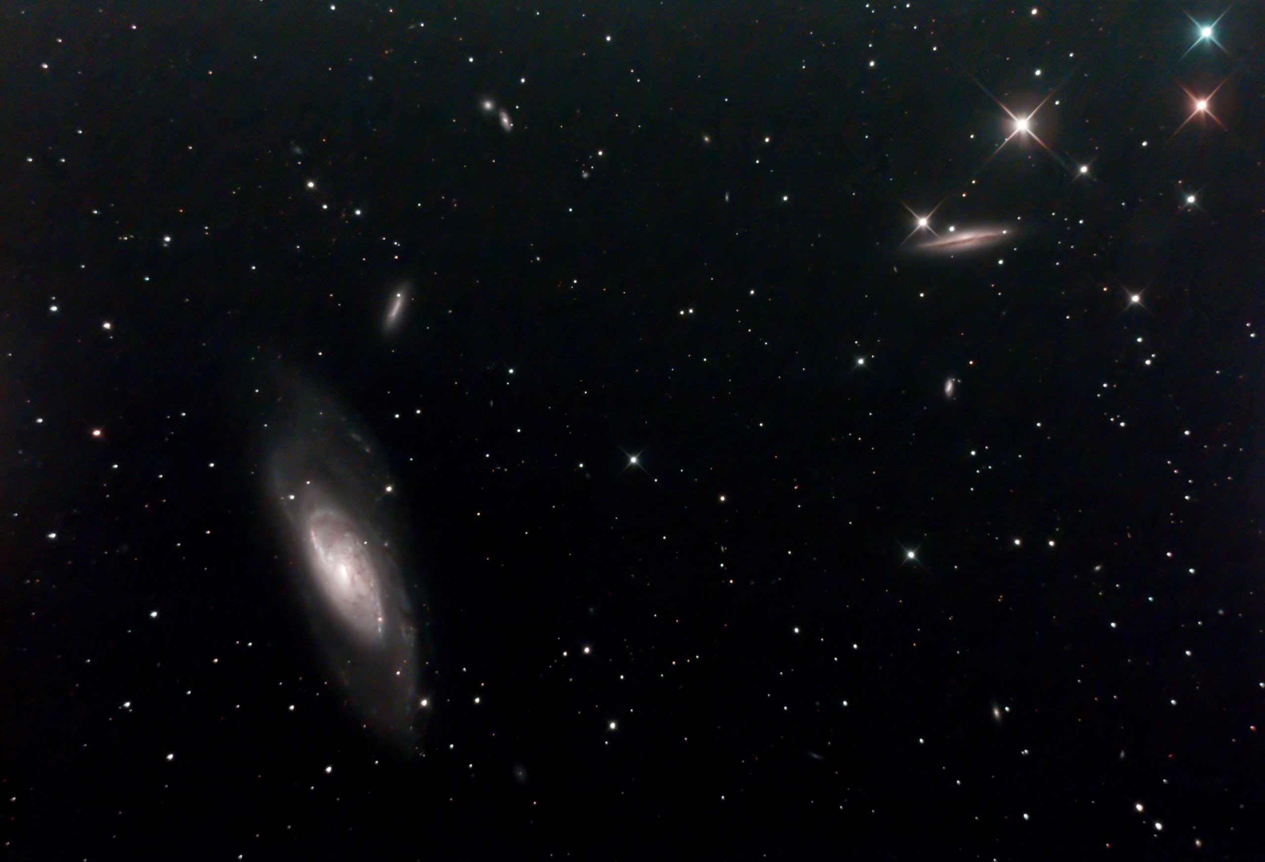 M106 Et Al (Ian A Smith) M106 and at least 8 neighbouring (on sky) galaxies such as NGC 4217, NGC 4248, NGC 4226, NGC 4232 and NGC 4231 . Skywatcher 200p on NEQ6 mount, with guiding and dithering. Canon 100d modified DSLR with Optolong CLS-CCD filter. 37 five minute exposures at ISO 800 (3 hours 5 minutes), 5 dark frames, 10 flat fields, 14 bias frames. 24th April 2020. Overnight temperatures were a bit higher than winter, leading to more noise in the image. Worth a return visit!
